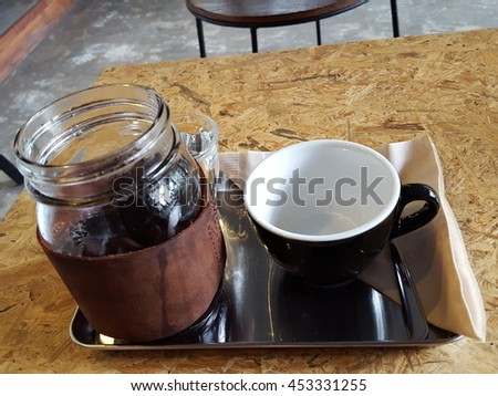 Drip brewing, filtered coffee, or pour-over is a method which involves pouring water over roasted, ground coffee beans contained in a filter. - stock photo