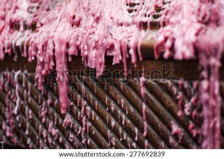 Dripped pink wax - stock photo