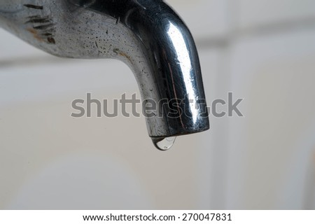 Dripping faucet. In water d'times of crisis it is important to save missing - stock photo
