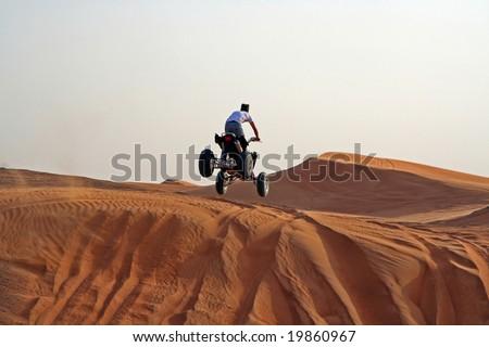 Drive a Quad bike in the desert of United Arabian emirates - stock photo