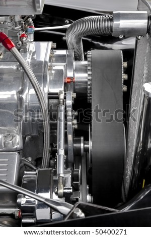 drive belt and parts on a performance car engine