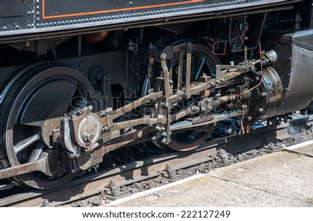Drive gear of old steam locomotive close up