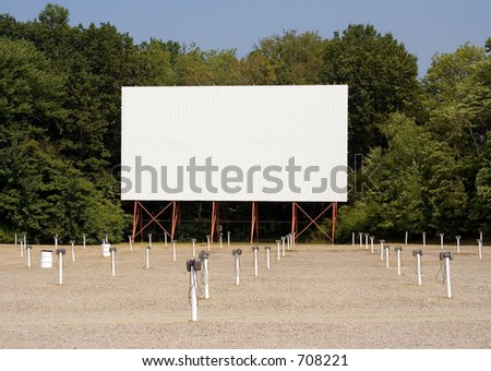 Drive in movie theater screen and speakers. Put your message on the screen! - stock photo