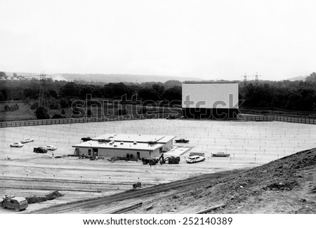 Drive-in movie theater under construction in Cleveland, Ohio, 1957. - stock photo