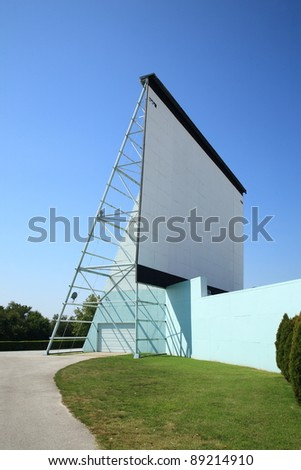 Drive In Theater movie screen against a sunny blue sky. - stock photo