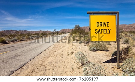 Drive Safely road sign at the South entrance to Joshua Tree National Park, California. - stock photo