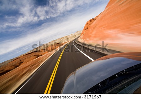 drive with motion blur, Bighorn Canyon, Wyoming - stock photo