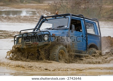 Driver competing in an off-road 4x4 competition
