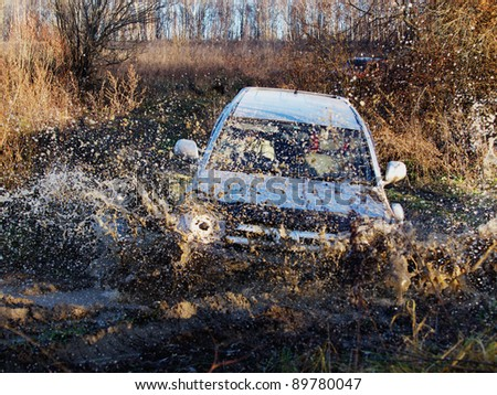 Driver competing in an off-road 4x4 competition - stock photo