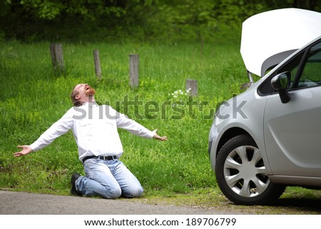 Driver furious a broken car by the road   - stock photo