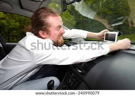 Driver furious on GPS navigation a wrong way - stock photo