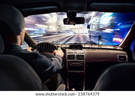 Driver going  fast through the town