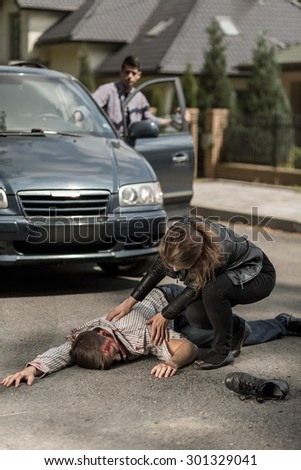 Driver hitting a pedestrian on the street - stock photo