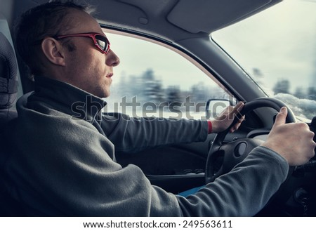 Driver into the car - stock photo