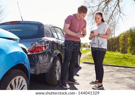 Driver Making Phone Call After Traffic Accident - stock photo