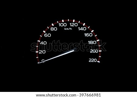 driver's cockpit ; speedometer on dashboard - white light in black  - stock photo