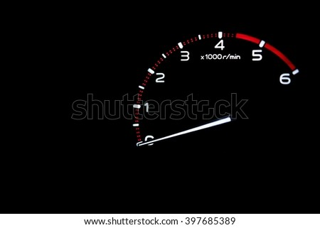 driver's cockpit ; tachometer on dashboard - white light in black and copy space  - stock photo