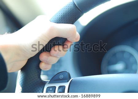 Driver's hand close up, shallow DOF