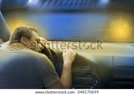Driver sleeping in the car just before a frontal crash with a lorry. - stock photo