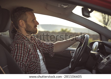 Driver. The young man behind the wheel. Toned photo. - stock photo
