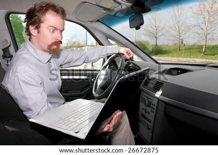 driver using gps laptop computer in a car - stock photo