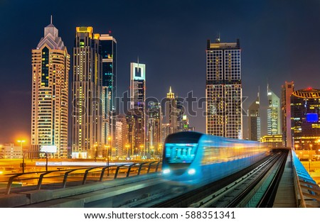 Metro stock images royalty free images vectors shutterstock driverless metro train with skyscrapers in the background dubai the united arab emirates voltagebd Choice Image