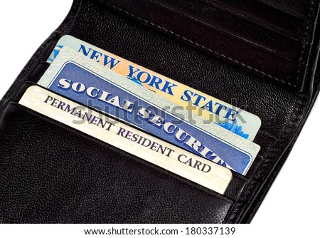 Drivers License,  Permanent resident and Social Security Cards in wallet - stock photo