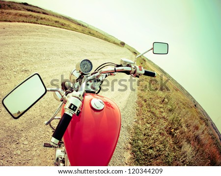 Drivers view of the cockpit in a modern motorcycle on the country road - stock photo