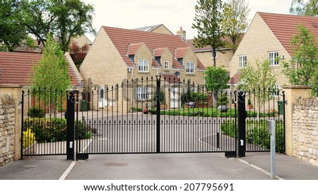 Driveway and Entrance of an Upscale Gated Community Housing Estate - stock photo