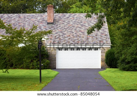 Driveway and garage in a typical American suburban neighborhood.