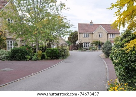 Driveway and Houses on a Typical English Residential Estate - stock photo
