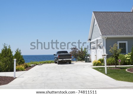 Driveway in summer luxury home - stock photo