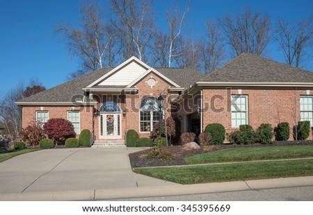 Driveway to Luxurious Brick House - stock photo