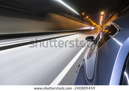 Driving a car at night trough tunnel  - stock photo
