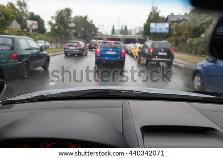 Driving a car in bad weather conditions in traffic jam - blurred view