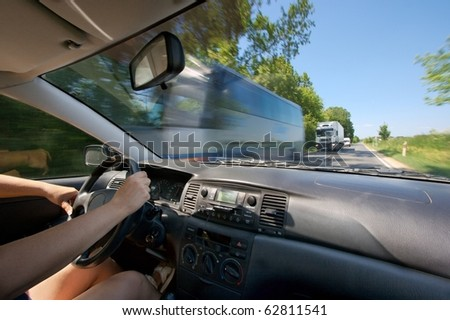 Driving a car on - stock photo