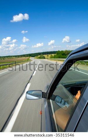 Driving a car on a highway - stock photo