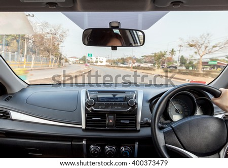 Driving a car on Highway.