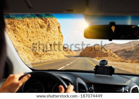 Driving a car on mountain road to Dead Sea - stock photo