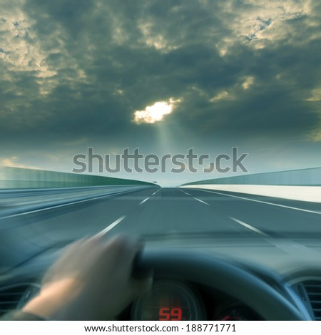 Driving a car steering wheel - stock photo