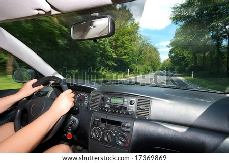 Driving a car through the countryside - stock photo