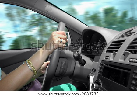 Driving a car with speed - stock photo