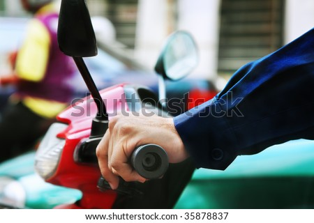 Driving a scooter - stock photo