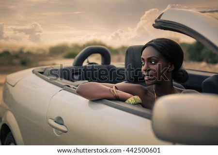 Driving a sporty car on vacation - stock photo