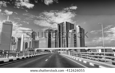 Driving across Dubai Downtown.