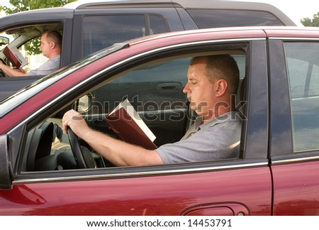 Driving and Reading - stock photo