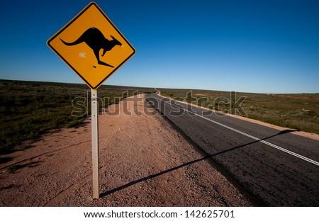 Driving around the Shark Bay in Western Australia - a kangaroo warning road sign. - stock photo