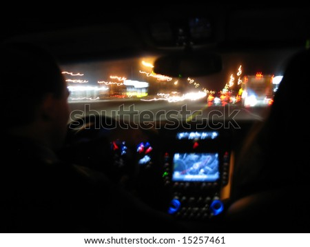 Driving at night in a modern luxury vehicle. - stock photo