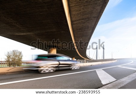 Driving blurred car on the interchange highway - stock photo