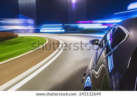 Driving car at night - stock photo